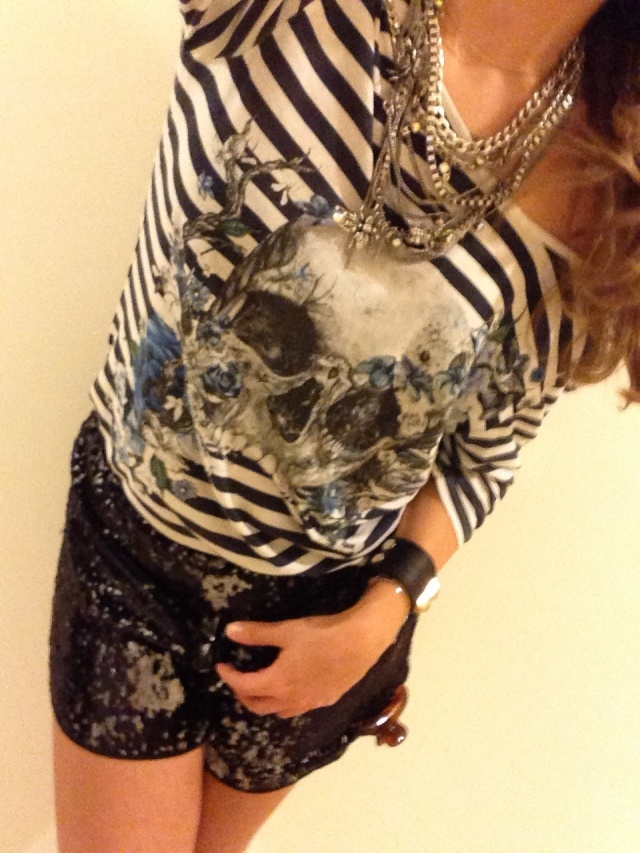 Striped t-shirt with skull motif by The Kooples, Multi-chain necklace by Zara, Sequined shorts by Clover Canyon